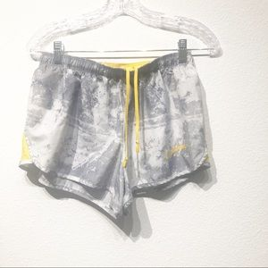 Yellow and grey Nike livestrong running shorts